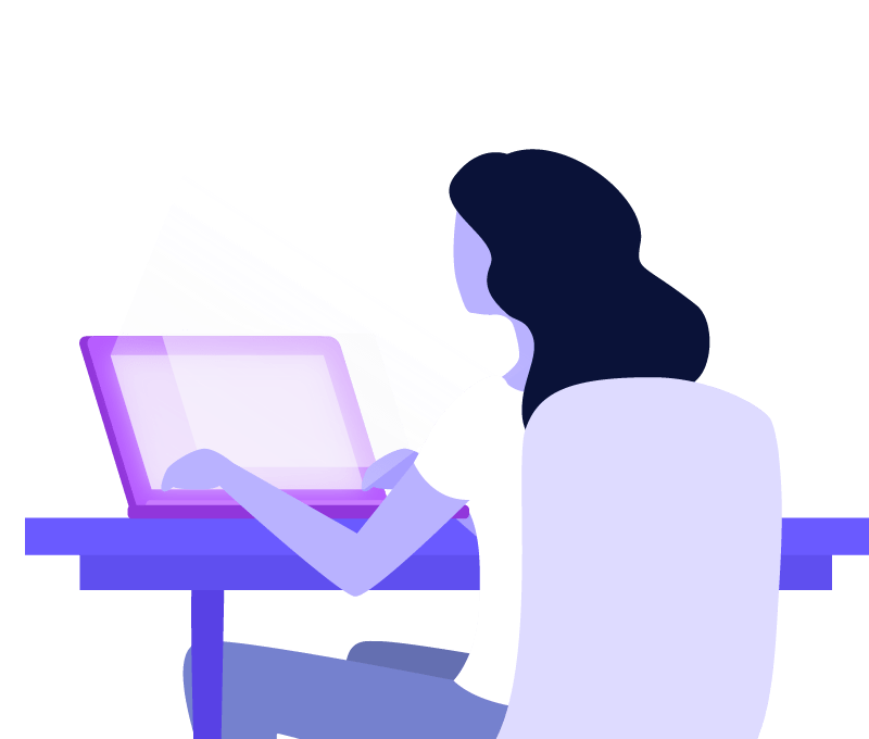 image of woman sitting at computer with back to the viewer